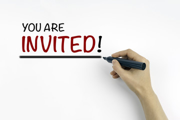 Hand with marker writing: You Are Invited