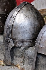 Conical Norman casque helmet placed on cur stone during medieval festival