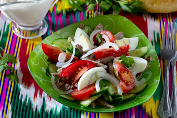 Fresh salad with beef, tomatoes, cucumber and egg - Bakhor. The