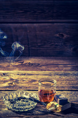 Vintage whiskey, cigarettes and ashtray