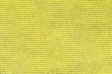Yellow tablecloth texture background, close up