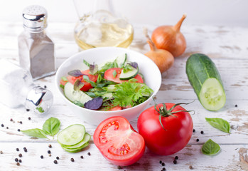 Salad. Tomatoes, cucumbers and onion.