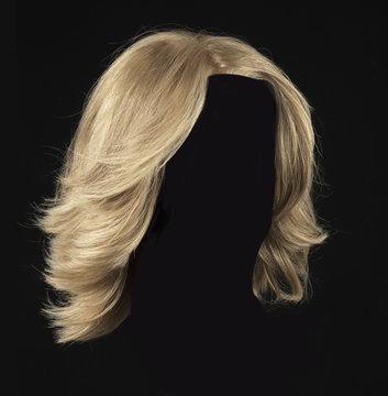female blonde wig on a black background
