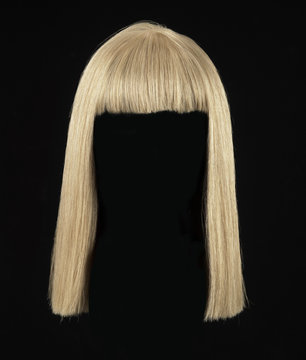 female blonde wig on a black background