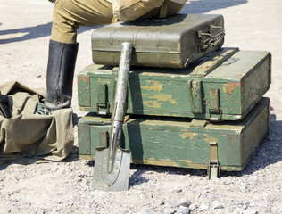 vintage military suitcase, army box of ammunition and sapper shovel