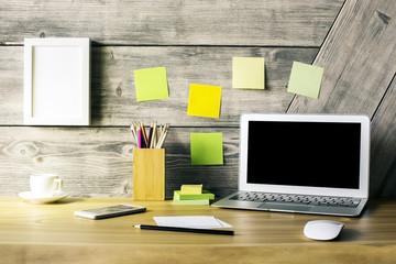 Designer desktop with laptop