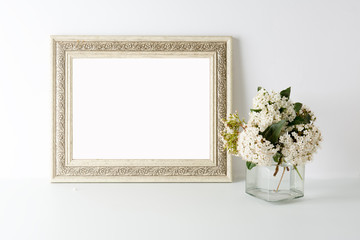empty picture frame, decorated with white flowers