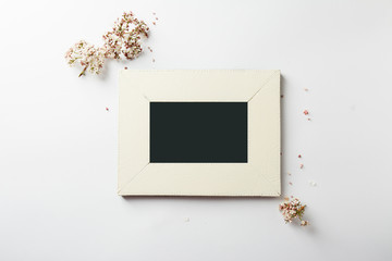 empty picture frame, decorated with pink flowers