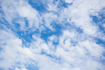 The blue sky with white cloud as background