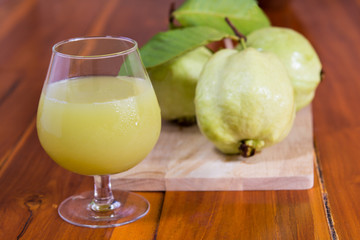 Green water guava on wood table