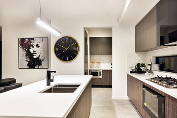 Modern kitchen countertop closeup with a stove and watch