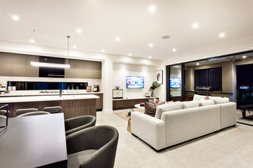 Modern living room with a television and sofas and pillows