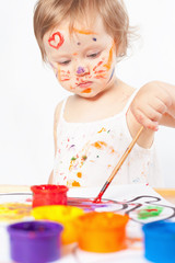Baby draws with colored inks paint