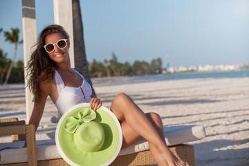 Woman relaxing at beautiful beach.