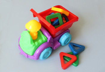 truck toy and colored shapes