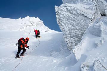 Climbing in mountains. Team work.