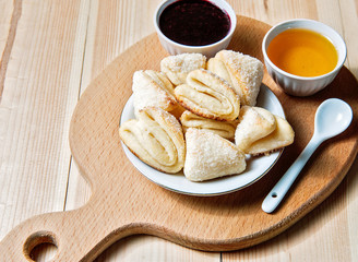 Cheese cookies with honey and jam as a countryside breakfast