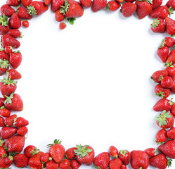 Fram from ripe strawberry on white background. Copy space, top view, high resolution product.