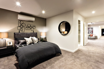 Modern bedroom with a hallway to other rooms