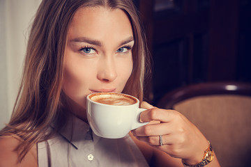 young woman drinks coffee