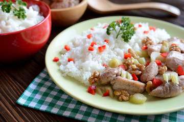 Roasted chicken meat with stalk celery, roasted walnuts and rice