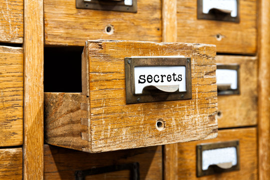 Secrets information concept image. Opened box archive storage, filing cabinet interior. wooden boxes with index cards. library service information management.
