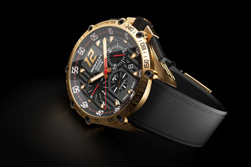Golden luxury wristwatch with black clock face on black backgrou