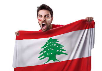 Fan holding the flag of Lebanon