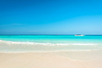 Wall Mural - Breathtaking turquoise sea, Exotic beach with gentle wave and clear on beach with blue sky
