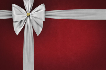 White bow and ribbon on red background