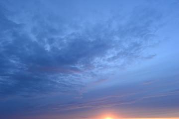 Blue cloudy sky at sunset on a summer evening