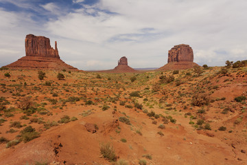 Classic view from dirt road of the West and East Mitten Buttes and Merrick's Butte on the right