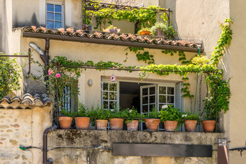 Houses with colorful terraces decorated with plants in the Luberon in the Provence region of the South of France