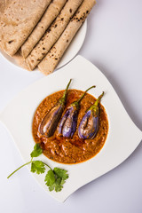 egg plant south indian curry, brinjal curry, brinjal masala also known as baigan masala or baingan fry in India, spicy and tasty dish served with chapati, main course