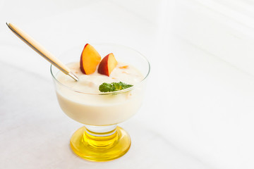 yogurt dessert with peaches