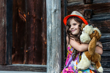 little girl sitting on the porch of the house