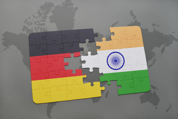puzzle with the national flag of germany and india on a world map background.