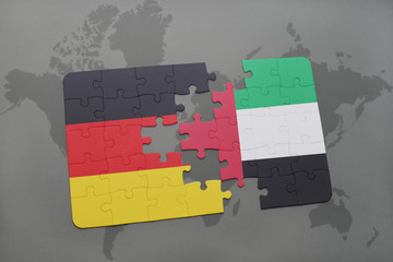 puzzle with the national flag of germany and united arab emirates on a world map background.