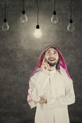 Arab man thinking idea under lightbulb