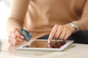 Girl with tablet and credit card