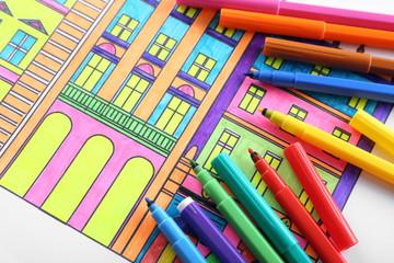 Adult anti stress coloring with soft tip pencils closeup