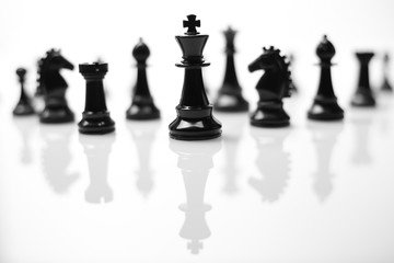 Teamwork - Chess pieces in a row