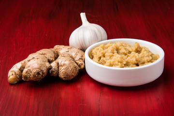 ginger and garlic paste or puree with 1 ginger and 1 garlic, closeup, selective focus, isolated
