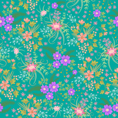 Seamless ditsy. Floral pattern. Flowers background. Vector illustration. Multicolored flowers on green background.