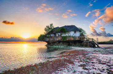 Restaurant the Rock at sunrise in the Indian ocean in Zanzibar,