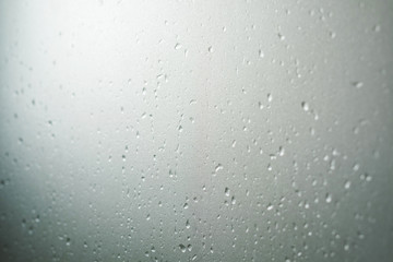Frosted glass texture with droplets, selective focus, shallow depth of field