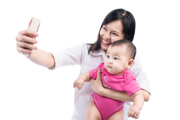 Funny baby girl looking at the camera and smiling, make selfie