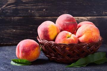 Ripe peaches in basket