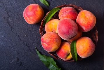 Ripe peaches in basket