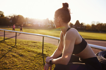 Woman Wearing Activity Tracker By Outdoor Running Track